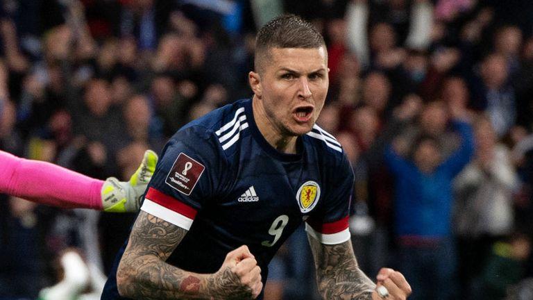 Lyndon Dykes celebrates equalising for Scotland