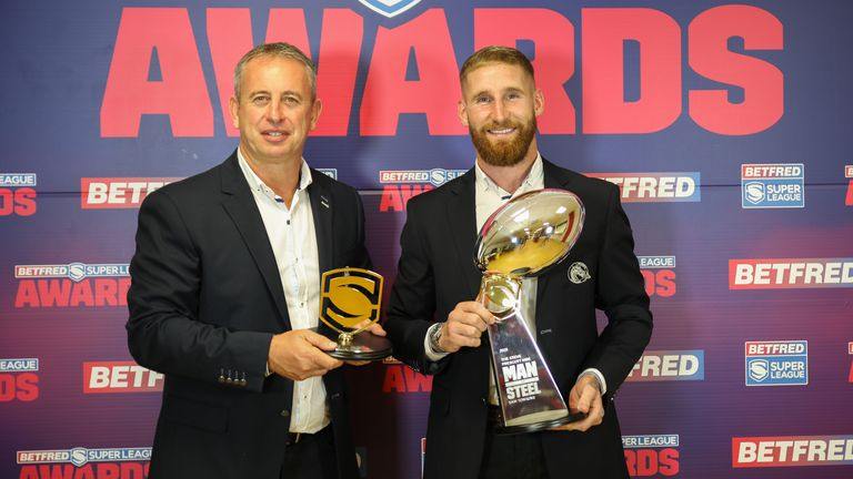Catalans Dragons duo Steve McNamara (head coach) and Tomkins stand with their awards