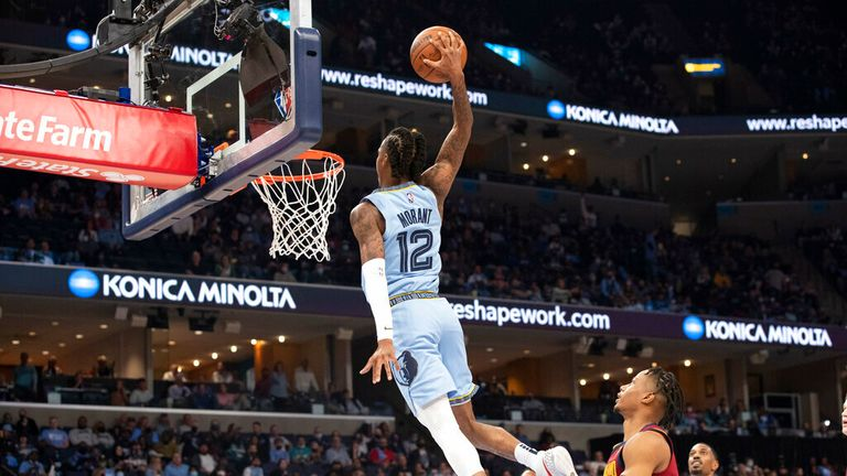 Memphis Grizzlies guard Ja Morant (12) goes up for a dunk agains the Cleveland Cavaliers during the second half of an NBA basketball game Wednesday, Oct. 20, 2021, in Memphis, Tenn. (AP Photo/Nikki Boertman)