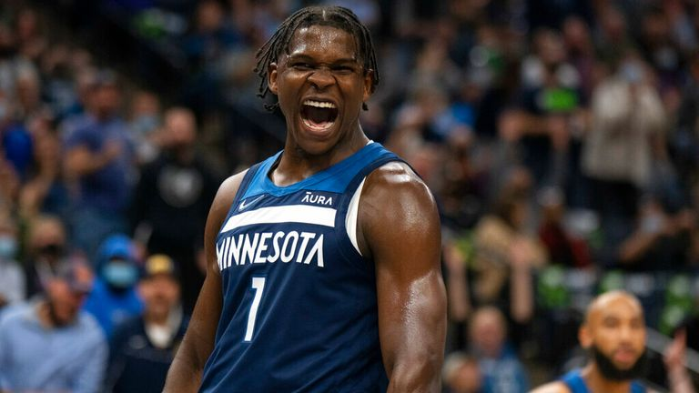 Minnesota Timberwolves guard Anthony Edwards (1) celebrates after a dunk against the Houston Rockets during the second quarter of an NBA basketball game Wednesday, Oct. 20, 2021, in Minneapolis. (Jeff Wheeler/Star Tribune via AP)