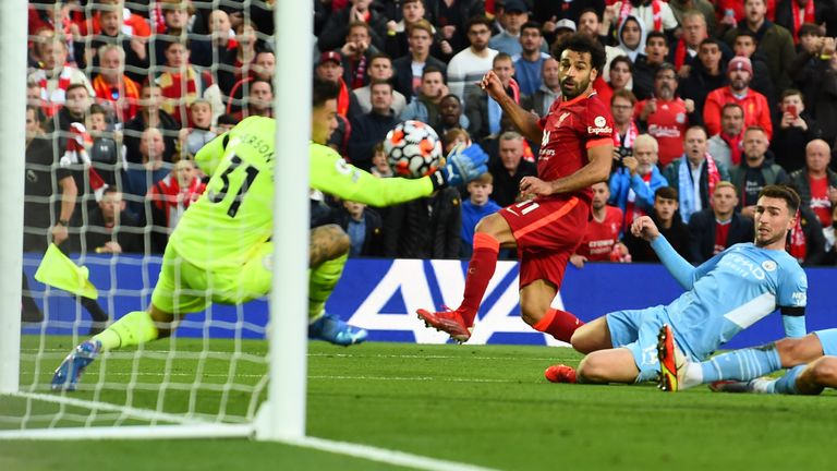 Mohamed Salah scores past Ederson after beating three Man City defenders to put Liverpool 2-1 up
