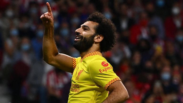 Mo Salah celebrates after scoring from the spot to give Liverpool a 3-2 lead