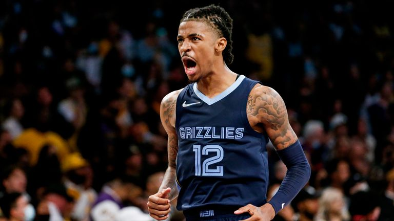 Memphis Grizzlies guard Ja Morant (12) reacts after getting a foul by the Los Angeles Lakers during the second half of an NBA basketball game in Los Angeles, Sunday, Oct. 24, 2021. The Lakers won 121-118.