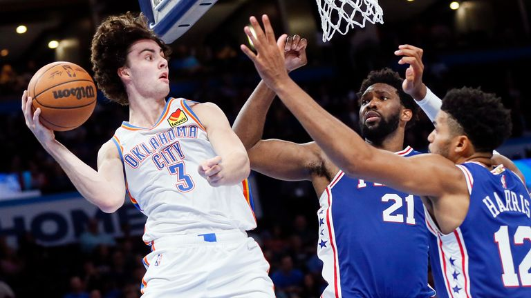 Oklahoma City Thunder guard Josh Giddey (3) tries to pass the ball away from Philadelphia 76ers center Joel Embiid (21) and forward Tobias Harris (12) in the second half of an NBA basketball game Sunday, Oct. 24, 2021, in Oklahoma City.