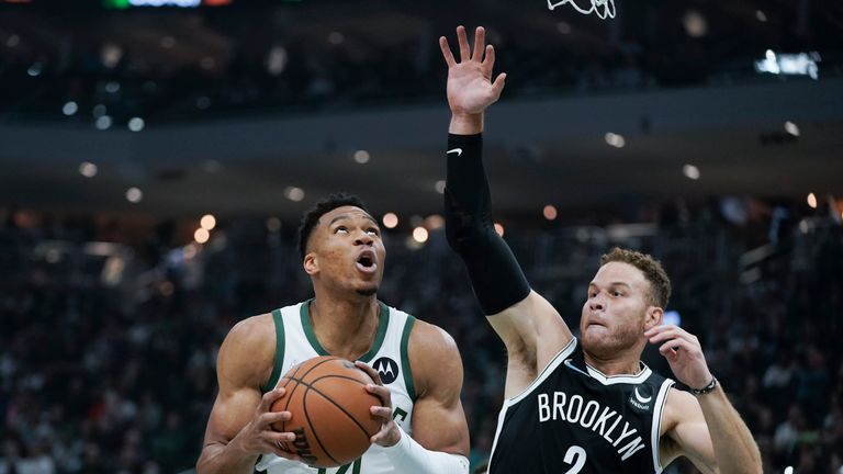 Milwaukee Bucks' Giannis Antetokounmpo (34) looks for a shot next to Brooklyn Nets' Blake Griffin (2) during the first half of an NBA basketball game Tuesday, Oct. 19, 2021, in Milwaukee. (AP Photo/Morry Gash)