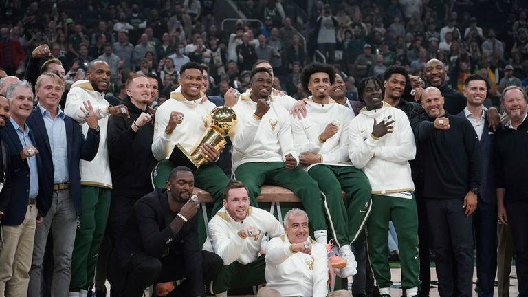 Milwaukee Bucks owners and players display their championship rings before an NBA basketball game between the Bucks and the Brooklyn Nets, Tuesday, Oct. 19, 2021, in Milwaukee. (AP Photo/Morry Gash)