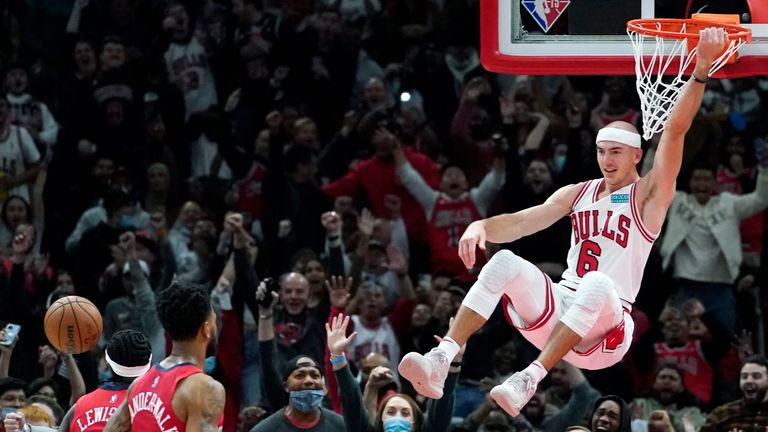 Chicago Bulls guard Alex Caruso, right, reacts after scoring during the second half of an NBA basketball game against the New Orleans Pelicans in Chicago, Friday, Oct. 22, 2021. (AP Photo/Nam Y. Huh)