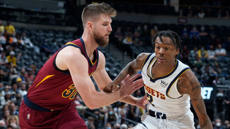 Denver Nuggets guard Bones Hyland, right, drives the lane as Cleveland Cavaliers forward Dean Wade defends in the second half of an NBA basketball game Monday, Oct. 25, 2021, in Denver.