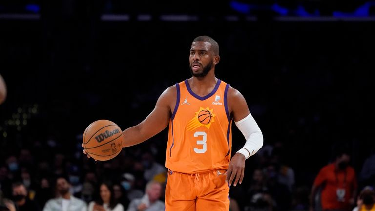 Phoenix Suns guard Chris Paul dribbles during the first half of an NBA basketball game against the Los Angeles Lakers Friday, Oct. 22, 2021, in Los Angeles. (AP Photo/Marcio Jose Sanchez)