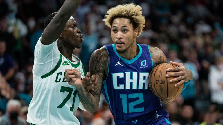 Charlotte Hornets guard Kelly Oubre Jr. (12) drives to the basket while guarded by Boston Celtics guard Dennis Schroder (71) during an NBA basketball game in Charlotte, N.C., Monday, Oct. 25, 2021.