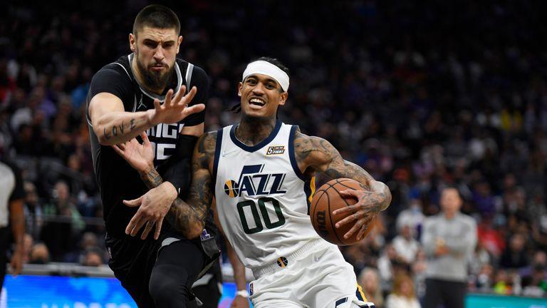 Utah Jazz's Jordan Clarkson drives to the basket past Sacramento Kings' Alex Len during the second half of an NBA basketball game in Sacramento, Calif., Friday, Oct. 22, 2021. The Jazz won 110-101. (AP Photo/José Luis Villegas)