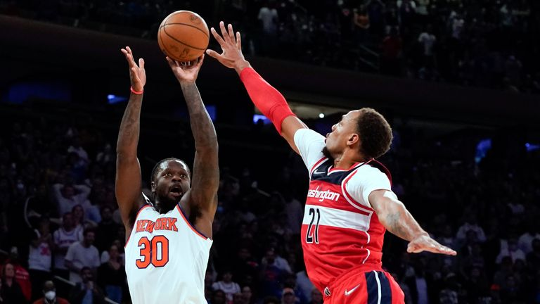 New York Knicks forward Julius Randle (30) shoots the go-ahead 3-pointer Washington Wizards center Daniel Gafford (21) in an NBA basketball game Friday, Oct. 15, 2021, at Madison Square Garden in New York. (AP Photo/Mary Altaffer)