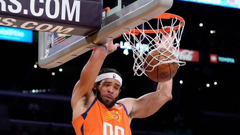 Phoenix Suns center JaVale McGee dunks during the first half of an NBA basketball game against the Los Angeles Lakers Friday, Oct. 22, 2021, in Los Angeles. (AP Photo/Marcio Jose Sanchez)