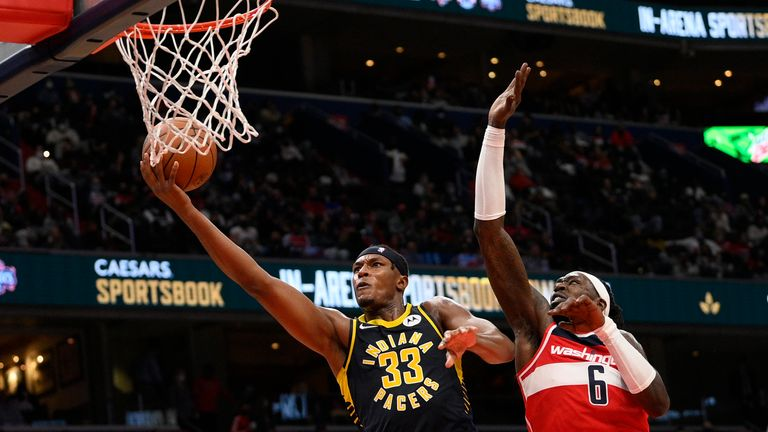 Indiana Pacers center Myles Turner (33) goes to the basket past Washington Wizards center Montrezl Harrell (6) during the second half of an NBA basketball game, Friday, Oct. 22, 2021, in Washington. (AP Photo/Nick Wass)
