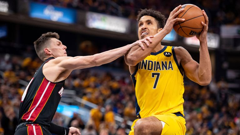 Indiana's Malcolm Brogdon drives to the basket as Miami's Tyler Herro attempts to foul