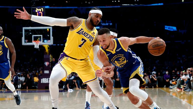 Golden State Warriors guard Stephen Curry (30) drives against Los Angeles Lakers forward Carmelo Anthony (7) during the second half of an NBA basketball game in Los Angeles, Tuesday, Oct. 19, 2021. The Warriors won 121-114. (AP Photo/Ringo H.W. Chiu)