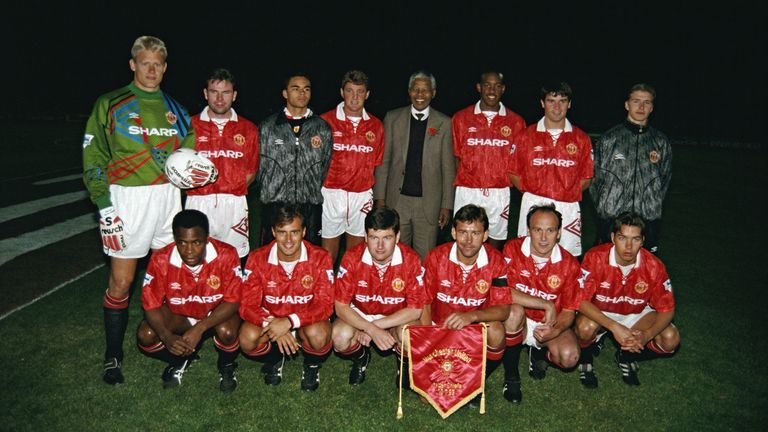 The Manchester United team pictured with Nelson Mandela during the team's tour of South Africa