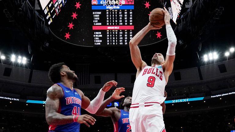 Chicago Bulls center Nikola Vucevic goes up to shoot against Detroit Pistons forward Saddiq Bey and center Isaiah Stewart