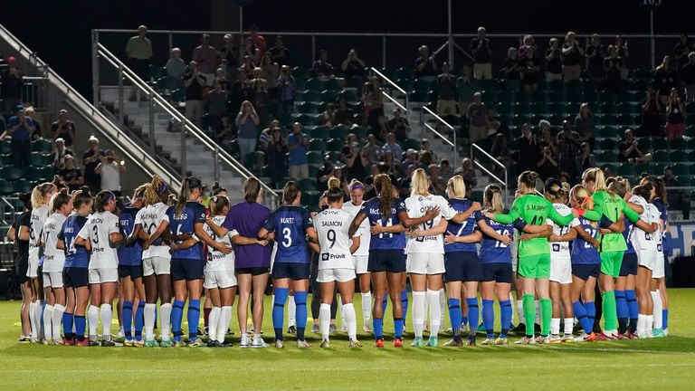 Play was halted as both teams linked arms in a show of solidarity