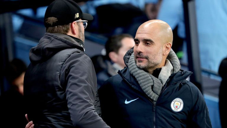 Manchester City manager Pep Guardiola (right) with Liverpool manager Jurgen Klopp (left) before kick-off during the Premier League match at the Etihad Stadium, Manchester. PRESS ASSOCIATION Photo. Picture date: Thursday January 3, 2019. See PA story SOCCER Man City. Photo credit should read: Richard Sellers/PA Wire. RESTRICTIONS: EDITORIAL USE ONLY No use with unauthorised audio, video, data, fixture lists, club/league logos or
