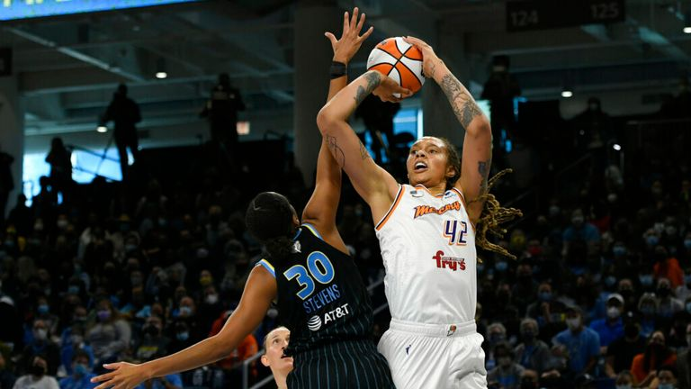 Phoenix Mercury's Brittney Griner (42) shoots against Chicago Sky's Azura Stevens (30) during the first half of Game 4 of the WNBA Finals, Sunday, Oct. 17, 2021, in Chicago. (AP Photo/Paul Beaty)