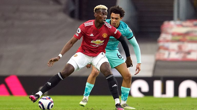 Manchester United's Paul Pogba (left) and Liverpool's Trent Alexander-Arnold battle for the ball during the Premier League match at Old Trafford