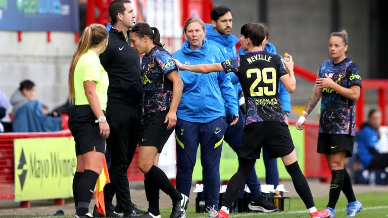Rachel Williams leaves the pitch after being shown a red card