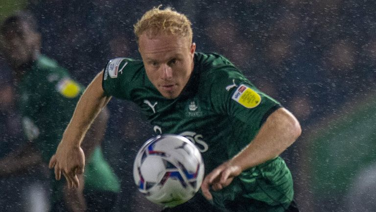 Plymouth's Ryan Broom stoops to head the ball at a waterlogged Home Park