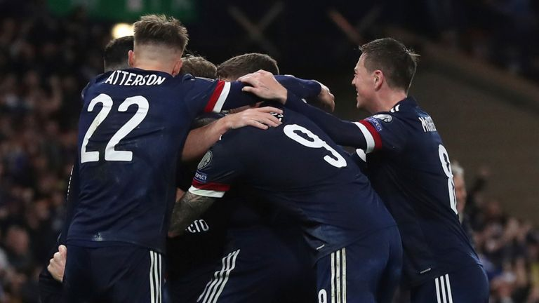 Scotland players mob Scott McTominay after he scored an injury-time winner