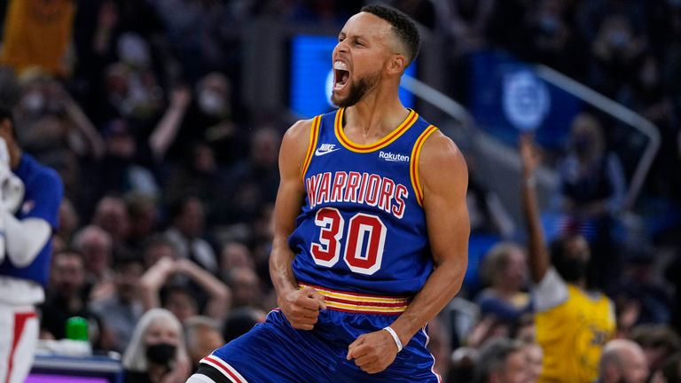 Golden State Warriors guard Stephen Curry reacts after making a 3-point shot against the Los Angeles Clippers