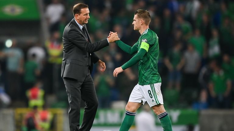 Northern Ireland manager Ian Baraclough, left, and Steven Davis of Northern Ireland after their side's draw in the FIFA World Cup 2022 qualifying group C match between Northern Ireland and Switzerland at National Football Stadium at Windsor Park in Belfast.