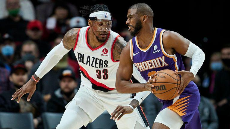 Phoenix Suns guard Chris Paul is defended by Portland Trail Blazers forward Robert Covington