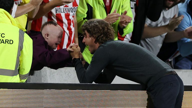 Thomas Frank celebrates Brentford's win over Arsenal with fan Woody O'Rourke