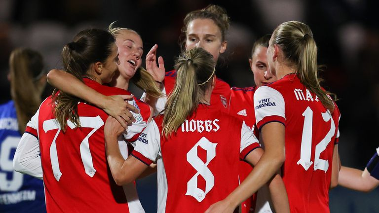 Tobin Heath is congratulated by teammates after giving Arsenal a two-goal lead