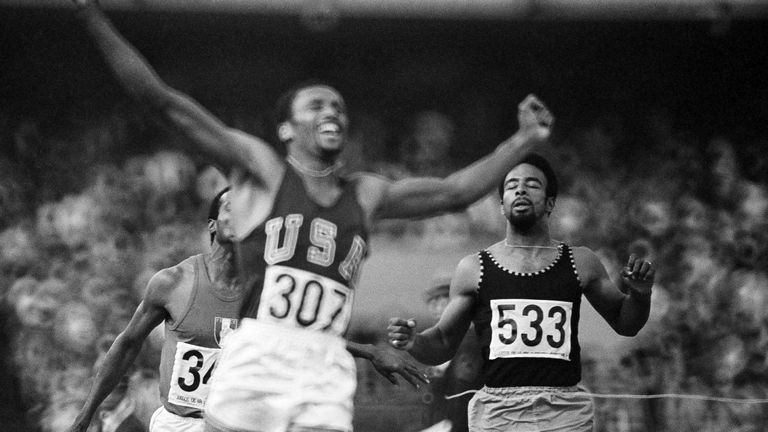 Smith celebrates as he crosses the finish line to win the Olympic 200m final in a world record time