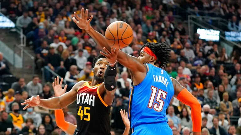 Utah Jazz guard Donovan Mitchell (45) goes to the basket as Oklahoma City Thunder center Derrick Favors (15) defends during the second half of an NBA basketball game Wednesday, Oct. 20, 2021, in Salt Lake City. (AP Photo/Rick Bowmer)