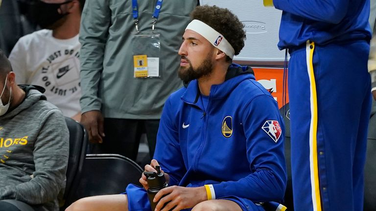 Golden State Warriors guard Klay Thompson sits courtside