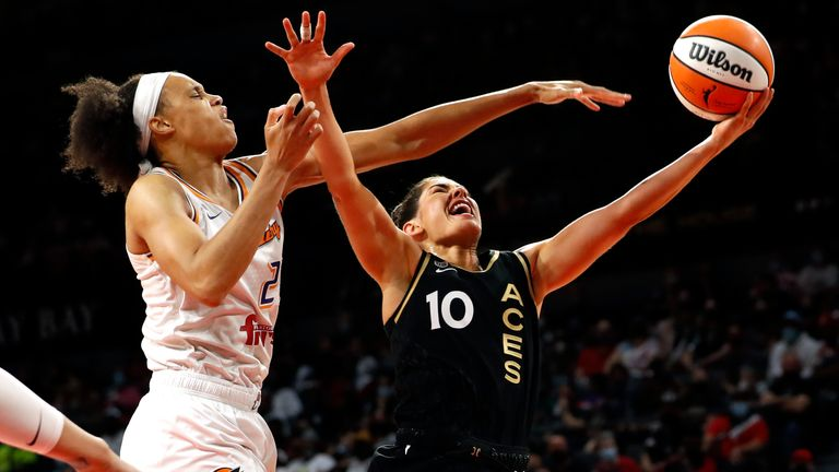 Las Vegas Aces guard Kelsey Plum (10) lays up the ball as Phoenix Mercury forward Brianna Turner (21) defends during the second half of Game 1 in the semifinals of the WNBA playoffs Tuesday, Sept. 28, 2021, in Las Vegas. The Aces beat the Mercury 96-90.