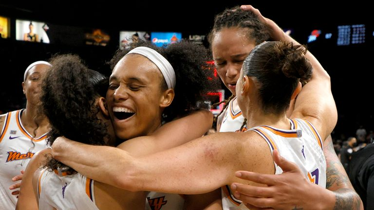 The Phoenix Mercury celebrate after defeating the Las Vegas Aces 87-84 in Game Five of the 2021 WNBA Playoffs semi-finals to win the series