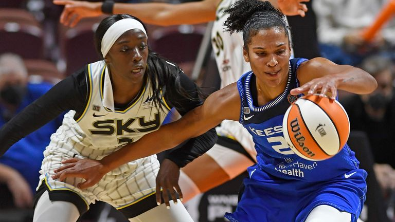 Connecticut Sun forward Alyssa Thomas, right, fends off Chicago Sky defender Kahleah Copper during a WNBA playoff basketball game Thursday, Sept. 30, 2021 at Mohegan Sun Arena in Uncasville, Conn.